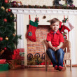 Happy little boy in Front Of Christmas Tree waiting — Stock Photo
