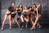Seven Cute go-go sexy girls in black with diamonds costume pulli — Stock Photo