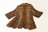 Beautiful ocelot fur coat — Stock Photo
