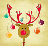 Reindeer with Christmas Tree Baubles tied to his antlers — Stock Vector