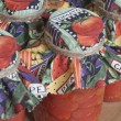 Canned Tomatoes with Colorful Canning Labels - Stock Photo