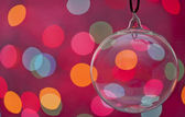 Clear Glass Christmas Ornament Hanging against bokah background — Stock Photo