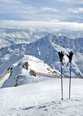 Ski poles and gloves in Alps — Stock Photo