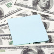 Note paper on dollars background — Stock Photo