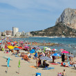 Beach of Calpe in July - Stock Photo