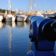 Touristic Telescope at the Barcelona Port - Stock Photo