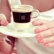 Cup of coffee in woman's hands — Stock Photo