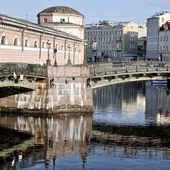 Old building and Bridge with reflection — Stock Photo