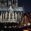 Cathedral and Hohenzollern Bridge in Cologne, Germany — Stock Photo #43727215