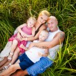Happy family in a park — Stock Photo