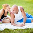 Happy young adults couple in a park — Stok fotoğraf