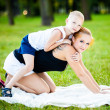 Little boy having fun with his mother — Stock Photo #12492488