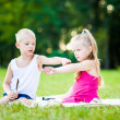 Little boy and girl  with ladybird in park — Stok fotoğraf