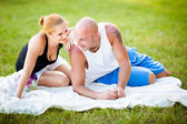 Happy young adults couple in a park — Stock Photo