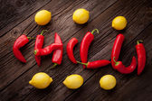 Chilli sign with fresh chillies and lemons — Stock Photo