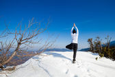 Winter yoga session in beautiful mountain place — Stock Photo