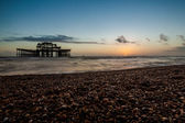 Sunset view on old Brighton pier and beach — Stock Photo