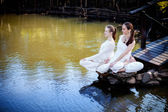 Outdoor yoga session in beautiful place by a lake — Photo
