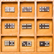 Dominos in wooden shadow box — Stock Photo #12492098