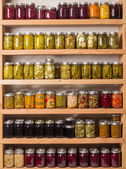 Shelves of canned goods — Stock Photo