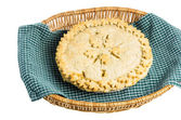 Homemdae peach pie in wicker basket — Stock Photo
