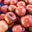 Stock Photo: Purple heirloom tomatoes on display