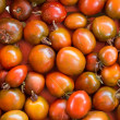 Stock Photo: Heirloom tomatoes on display