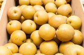 Fresh asian pears in wooden crate — Stock Photo