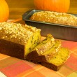 Pumpkin bread loaf sliced with pumpkins — Stock Photo