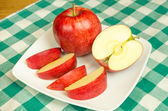 Jonagold apple slices on a white plate — Stock Photo