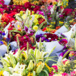 Display of flower arrangements at the market — Stock Photo