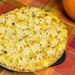 Turkey pot pie with pumpkin on table — Stock Photo #17869417