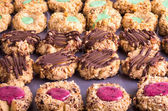 Rows of thumbprint cookies with nuts — Stock Photo