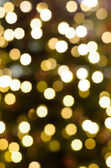 Background of unfocused Christmas lights — Stock Photo