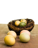Colorful Easter eggs on wooden table — Stock Photo