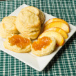 White plate with biscuits and peaches — Stock Photo #18997125