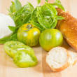 Stock Photo: Heirloom tomatoes with bread and cheese