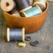 Royalty-Free Stock Photo: Wooden bowl with spools of thread