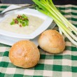 Bowl of potato leek soup with rolls — Stock Photo #20101871