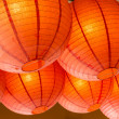 Group of paper lanterns hanging from the roof — Stock Photo