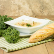 Hearty soup with kale and bread — Stock Photo