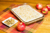 Apple cake with plate of walnuts and apples — Stock Photo