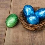 Small bird's nest with four foil eggs — Stock Photo