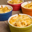 Bright bowls of baked macaroni and cheese — Stock Photo #24921567