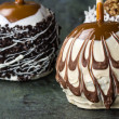 Chocolate or caramel covered apples — Stock Photo