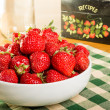 Stock Photo: Bowl of strawberries with recipe box