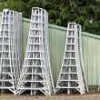 Aluminium harvest ladders stored by shed — Stock Photo #26220039
