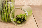 Jars of asparagus being canned — Stock Photo