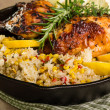 Lemon chicken with rice and roasted corn — Stock Photo