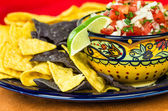 Bowl of spicy salsa and corn chips — Stock Photo